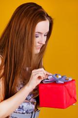 beautiful woman opening a gift