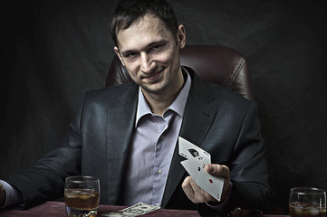 business man winner playing poker