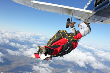 Skydiver jumps from an airplane