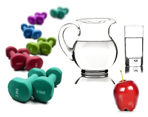 W ater in a pitcher and glass  apple with dumbbells
