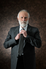 a man fixes the tie
