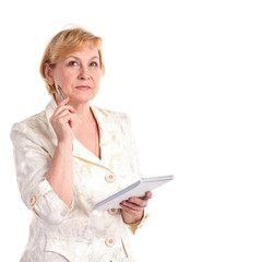 Pretty mature businesswoman with pen and notebook