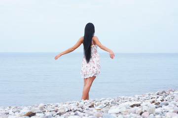 A young and beautiful woman near the sea