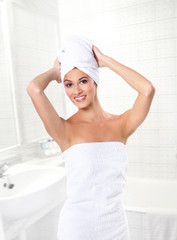 A young Caucasian woman after taking a bath