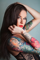 pretty young girl with tattoo