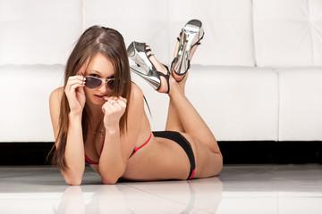 Sweet brunette lady in sensual bikini and sun glasses