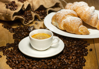 coffee cup with croissant