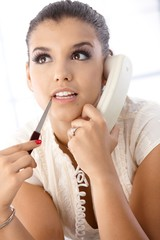 Portrait of beautiful woman on phone