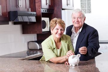 happy senior couple saving for retirement