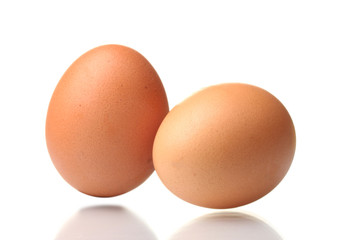two brown eggs isolated on white