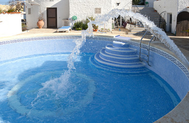 Filling a Swimming Pool with water after cleaning in Spain