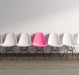 Pink plastic 60s vintage chair on wood floor