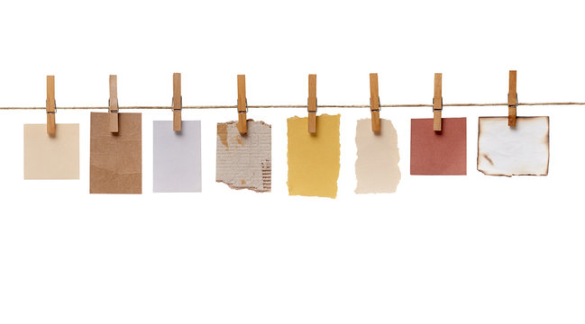 clothes peg and note paper on clothes line rope
