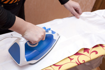 Process of ironing of a white dressing