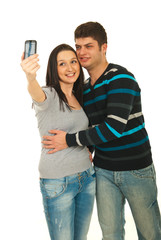 Couple taking photo with their phone