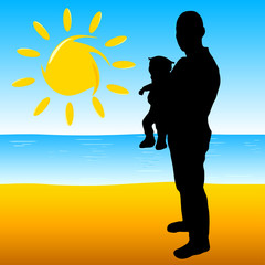 father with a baby on the beach
