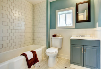 New remodeled blue bathroom with classic white tile.
