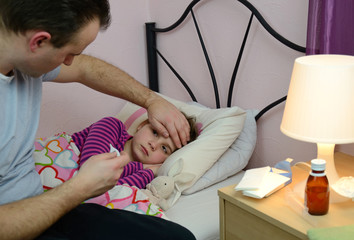 Father take care of sick daughter