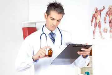 Doctor Holding Clipboard and Bottle