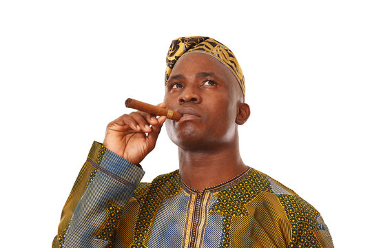 Portrait of young trendy african american man smoking a cigar