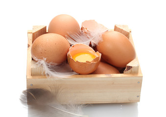 chicken eggs in wooden box isolated on white