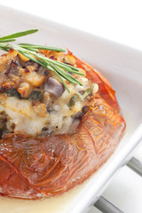 baked tomato with chicken meat and mushrooms