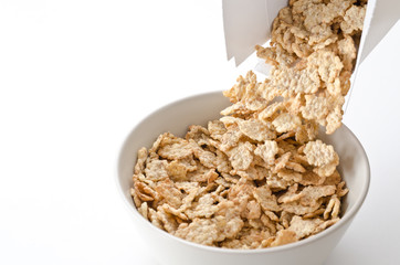 Cereals pouring into a bowl