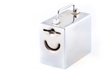 Metal money box and coin over white
