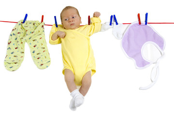 Baby hanging on the clothesline