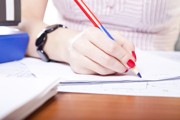 young adult businesswoman writing