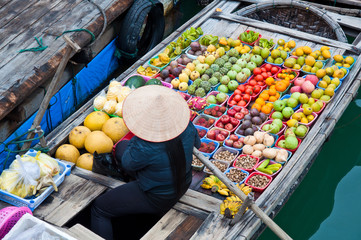 Greengrocer on bamboo floating boat, halong bay, Vietnam