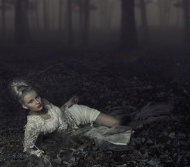 Blond beauty laying on leaves