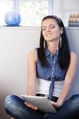 Pretty girl enjoying music eyes closed