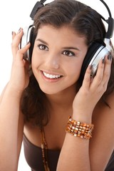 Portrait of woman with headphones smiling