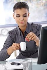Pretty businesswoman with coffee