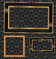 Empty gold and black frames on the wall