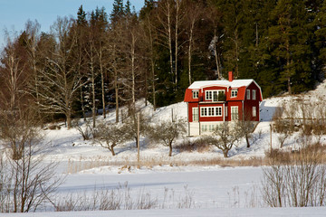 Typical red house in Sweden in wintertime.