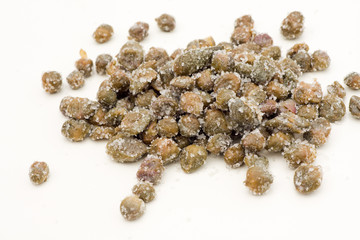 Salted capers of Pantelleria on a white background