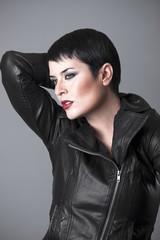 Beautiful brunette on leather jacket