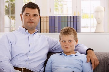 Portrait of father and son at home