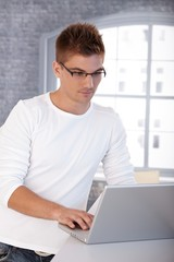 Trendy young man with laptop