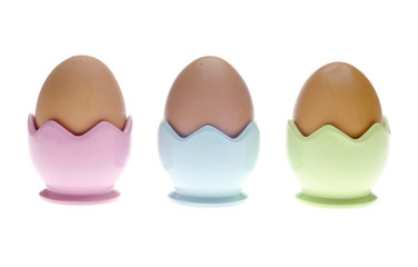 Three Pastel Egg Cups with Brown Eggs