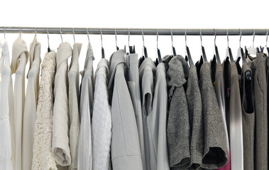 Variety of casual fashion clothes on hangers