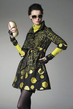 fashion model wearing sunglasses holding purse