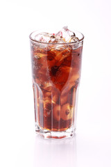 Cola in highball glass, isolated on white background