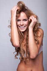 Portrait of delicate smiling woman