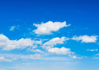 Deep blue sky with some white clouds
