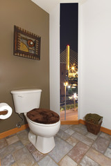 Toilet with green wall and art in brown