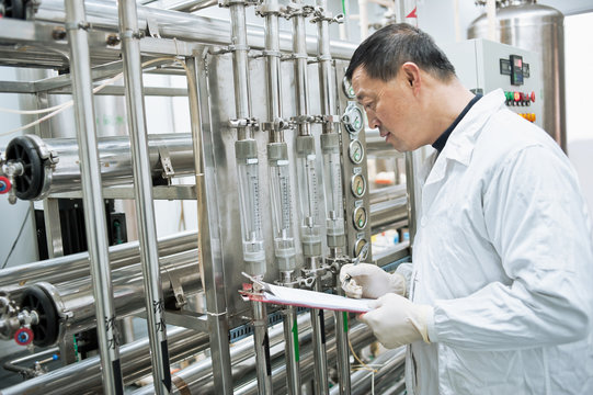 Pharmaceutical factory technician at work