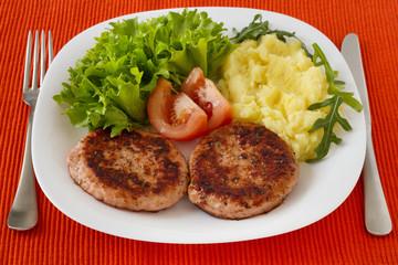 grilled turkey hamburgers with mashed potato and salad